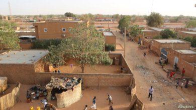 People Walk In A Courtyard In Niamey
